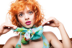 Girl with red hair and colorful dress over white Royalty Free Stock Photo