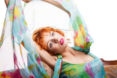 Girl with red hair and colorful dress over white Royalty Free Stock Photos