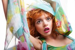 Girl with red hair and colorful dress over white Royalty Free Stock Image