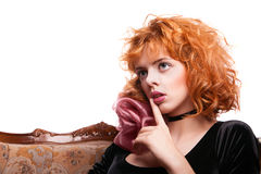 Girl with red hair making a hush gesture Royalty Free Stock Images