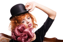 Girl with red hair, pink bow over white Stock Image