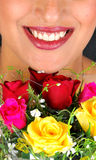 Girl with beautiful smile and roses Stock Photo