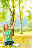 Girl with a beautiful smile sitting in the park Stock Photo
