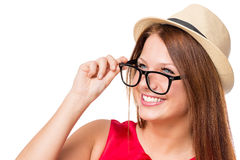 Girl with a beautiful smile wearing glasses and a hat Stock Photo