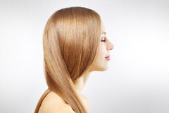 Girl with beautiful straight hair on gray Royalty Free Stock Photo