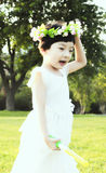 Girl. The beautiful girl to play on the lawn Royalty Free Stock Photos