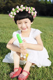 Girl. The beautiful girl to play on the lawn Royalty Free Stock Photography