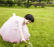 Girl. The beautiful girl to play on the lawn Stock Images