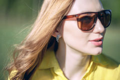 girl, beautiful, young, blonde, big sunglasses in close-up Stock Image