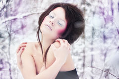 Girl with beauty make-up in a winter forest Royalty Free Stock Photography