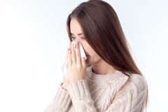 Girl became ill and holds a handkerchief near the nose Royalty Free Stock Photos