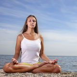 Girl on bech. Beauty girl on bech in lotus pose Royalty Free Stock Image