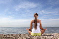 Girl on bech. Beauty girl on bech in lotus pose Stock Photo