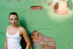 Girl beside the wall royalty free stock photography
