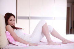 Girl on bed Stock Image