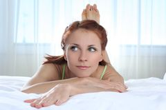 Girl on bed Royalty Free Stock Photos
