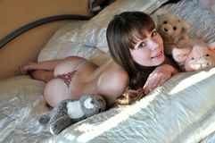 Girl in bed Stock Images