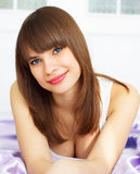 Girl on the bed Stock Images