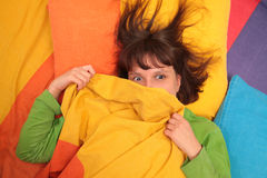 Girl in bed. Surprise, fear Royalty Free Stock Photos