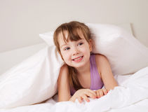 Girl on the bed Stock Photos
