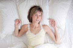Girl in a bed Stock Images