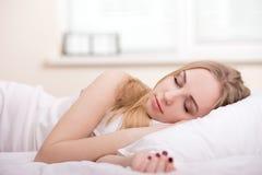 Girl In Bed. Beautiful girl sleeps in the bedroom Royalty Free Stock Photos