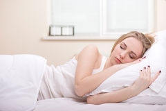Girl In Bed. Beautiful girl sleeps in the bedroom Royalty Free Stock Photo