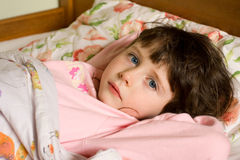 Girl in bed Royalty Free Stock Photos