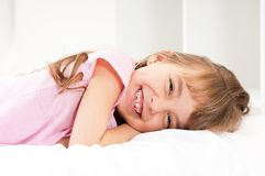 Girl on bed Stock Photography