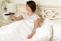 Girl on the bed is chatting on the phone Royalty Free Stock Image