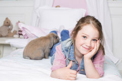 Girl on the bed Royalty Free Stock Image