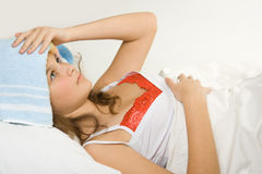 Girl in the bed expressing flu Stock Photos