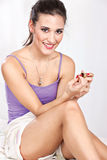 Girl in bed girl applying nail polish. Pretty girl in bed girl applying nail polish Royalty Free Stock Photo
