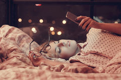 Girl in bed. Home. Girl lying in bed stock photos
