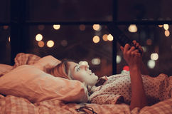 Girl in bed. Home. Girl lying in bed stock photography