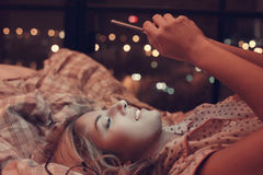 Girl in bed. Home. Girl lying in bed royalty free stock photo
