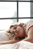 Girl in bed. Home. Girl lying in bed royalty free stock photography