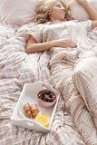 Girl in bed. Home. Girl lying in bed stock photo