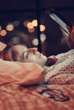 Girl in bed. Home. Girl lying in bed royalty free stock image
