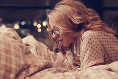Girl in bed. Home. Girl lying in bed royalty free stock images