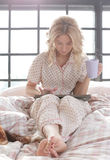 Girl in bed Royalty Free Stock Photo