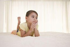 Girl In Bed Looking Away Royalty Free Stock Photography