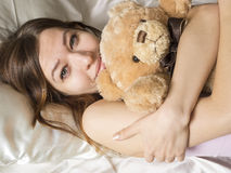 Girl in the bed Stock Image