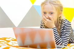 Girl play on the tablet stock photography