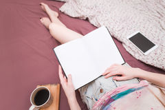 Girl in bed reading a book. Inspirational reading royalty free stock photo