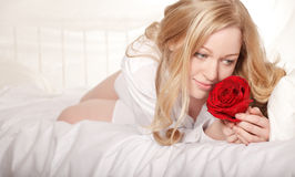 Girl In Bed With Rose Royalty Free Stock Photography