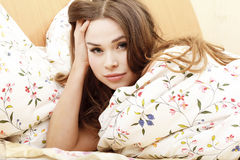 Girl in a bed before or after sleep Stock Image