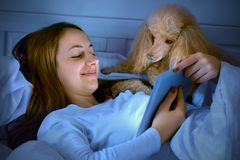 Girl  on the bed with tablet. Stock Photography