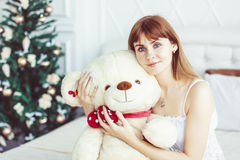 Girl in bed with Teddy bear Royalty Free Stock Image