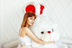Girl in bed with Teddy bear Royalty Free Stock Images